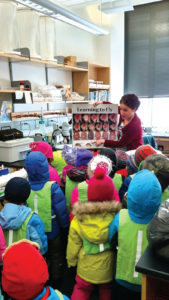 Melissa instructs the next generation of fly researchers