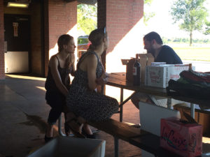 """Danielle and Katharine """"discuss science"""" at the Hodonger-Merrison joint lab picnic (with the Hoskins, Wildonger and Mehl labs)"""